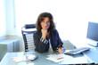 Geschaftsfrau am Schreibtisch