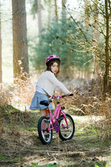 Young Girl with her Bike in the Forest