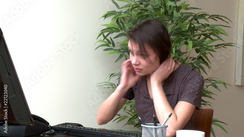 Depressed woman working at a computer