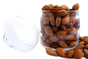 isolated almonds in glass pot
