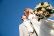 kissing wedding pair