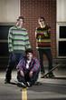 Three skateboarder friends together