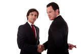 two businessmen shaking hands, businessman with fingers crossed