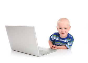 Happy Smiling Preschool Child Learning on a Modern Computer