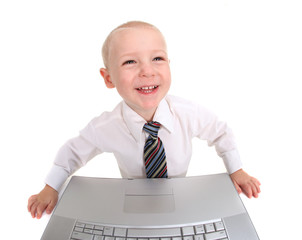 Happy Well Dressed Child Working on a Laptop Computer