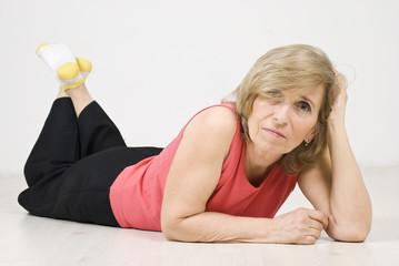 Beauty mature woman posing on floor