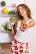 Cheerful young woman with fresh vegetables