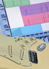 Home recording studio with closeup of guitar and music software