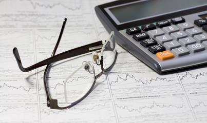 Balancing the Accounts. Calculator, glasses