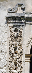 Carving on the wall of an old Sicilian church in Syracuse