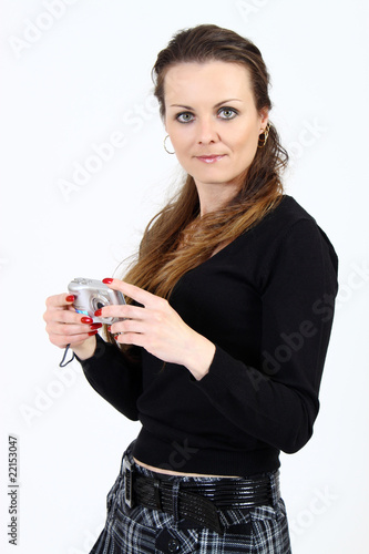 The attractive woman with digital camera  on white background