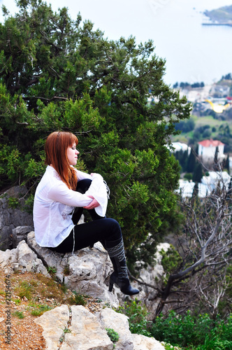 pensive girl on the cliff