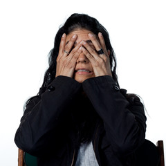 Hispanic woman covering her face