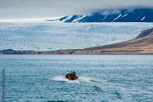 A small boat approaching the glacier Nordenskiöldbreen