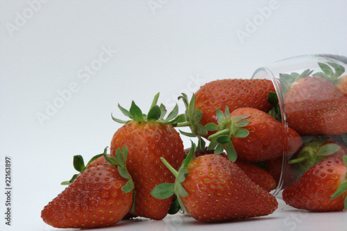 Strawberries spilling out of a glass