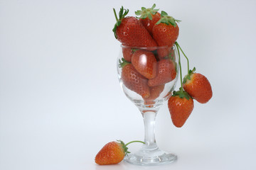 Wine glass filled to the top with strawberries
