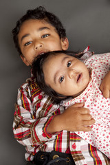 Portrait of Brother and Newborn Sister