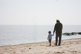 grandad and grandson on the beach poster