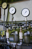 Industrial faucets and manometers in factory poster
