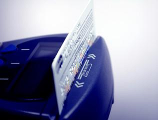 Closeup of credit card and pos terminal