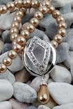 Pearl, diamond jewelery on stones background poster