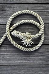 marine rope over gray aged teak wood