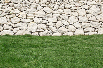 Stone wall and grass below