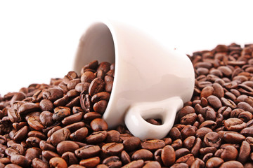 Small white cup of coffee with coffee grain on grain background