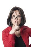 jeune femme demande de silence index sur la bouche poster