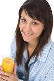 Smiling woman drink orange juice in pajamas poster