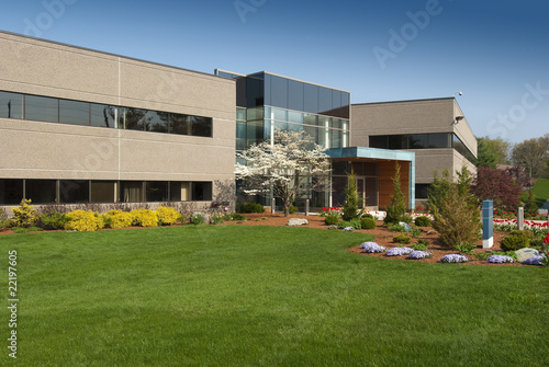 canvas print picture Modern commercial building located in industrial park