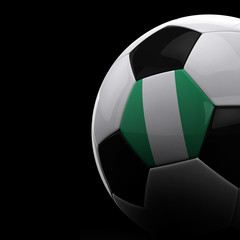 Nigerian soccer ball over black background