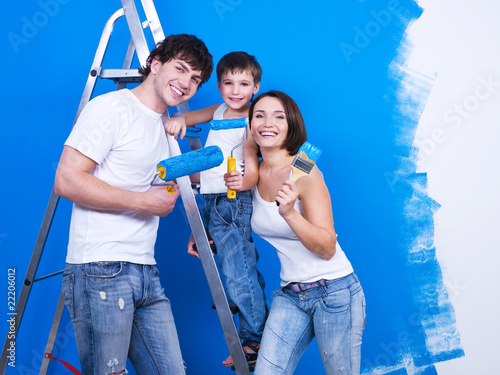 Happy family with paintbrush