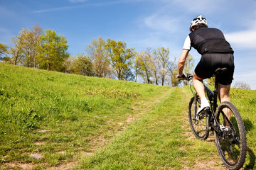 Mountain bike cyclist riding uphill