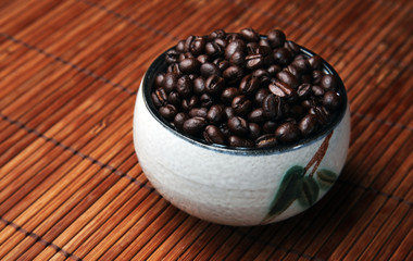 Coffee beans displayed in a cup