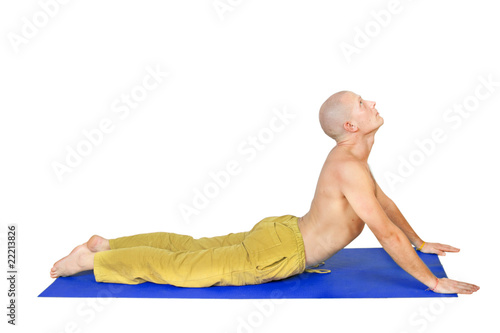 Yoga. Man in  bhujanga asana position