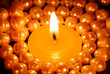 Burning candle in the centre of pearls