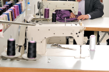 Tailor using industrial sewing machine.