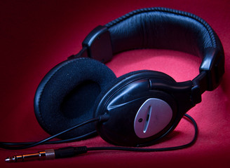black headphones on a red background