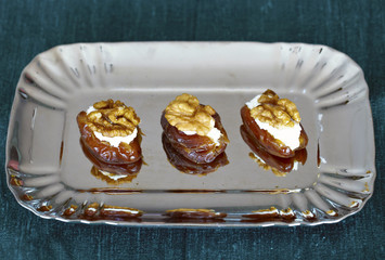 Dates filled with ricotta cheese and walnuts