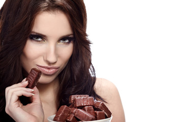 Girl eating a chocolate candy