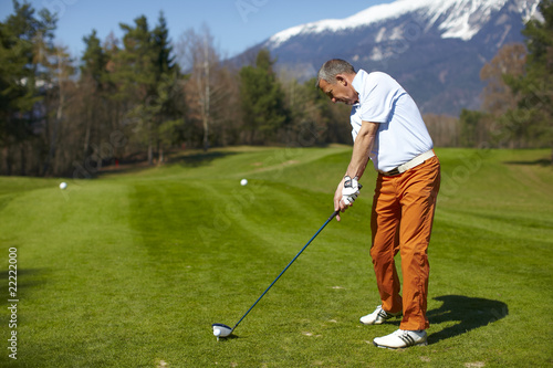 Man golfer preparing for a swing