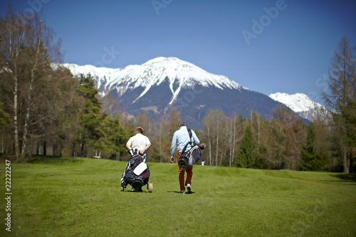Two man walking on a golf course
