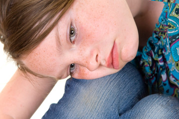 Young girl looking sad