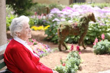 elderly woman sitting in the sun