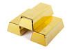 drei Goldbarren gestapelt