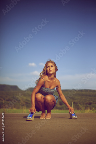 Blond woman bare foot on the road