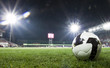 Soccer ball in stadium at night - 22238094