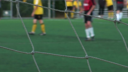 Soccer match through net - HD