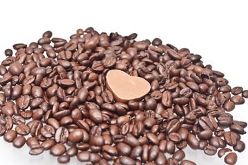 Coffee beans with heart shape chocolate sweet